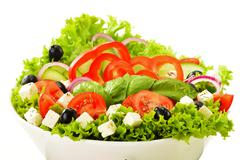vegetable salad bowl isolated on white background - stock photo