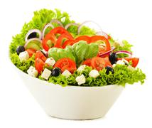 Vegetable salad bowl isolated on white background Stock Photos