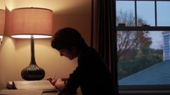 High School Student Working on Homework Stock Footage