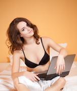 sensual young woman using laptop. - stock photo
