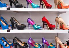 Background with shoes on shelves Stock Photos