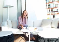 businesswoman talking on the phone in a coffee shop - stock photo