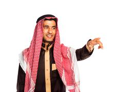 arab man pressing virtual button on white - stock photo