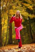 Stock Photo of healthy active lifestyle. fitness woman doing exercise outdoor.