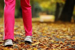 runner legs and running shoes. sporty woman jogging walking outdoors. - stock photo