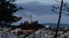 Stock Video Footage of Famous Telegraph Hill Coit Tower Dusk Twilight Light San Francisco Skyline USA