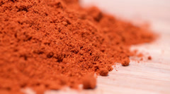 Portion of paprika powder (loopable) Stock Footage