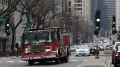 American Fire Truck Passing High Speed Emergency Firefighters Team Burn Rescuers - stock footage