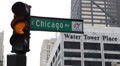 Yellow Red Traffic Light Chicago Avenue Street Sign Water Tower Place Building HD Footage
