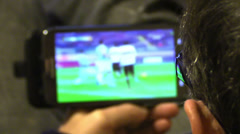 Man watching football match on tablet computer Stock Footage