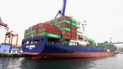 Container ship under loading Stock Footage