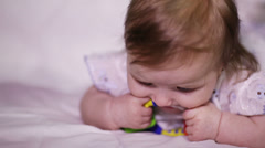 Baby eats rattle Stock Footage