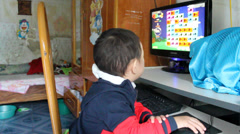 Boy playing games on computer Stock Footage