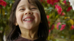 Cheerful Smiling Girl In A Garden Stock Footage
