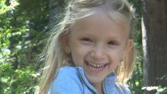 Portrait of Laughing Child, Happy Little Girl Smiling, Fun in Forest, Children - stock footage