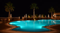 Swimming pool at the luxury hotel with blue color of water, halkidiki, greece Stock Footage