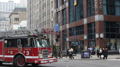 Firefighters Chicago Fire Truck Engine Passing Magnificent Mile People Crossing Stock Footage