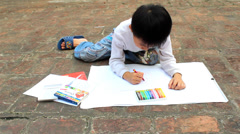 boy drawing with crayons - stock footage