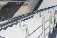 staircase with metallic stair railing - stock photo