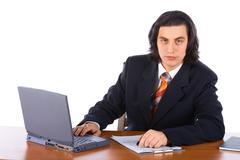 young successful businessman typing on laptop - stock photo