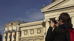 Tourist taking pictures with a smartphone, historical building, traveling Stock Footage