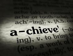 Dictionary - Achieve - Black On BG - stock photo