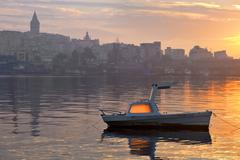 Boat in golden horn at dawn Stock Photos
