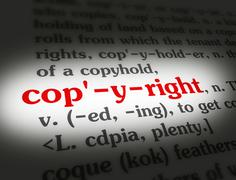 Dictionary - Copyright - Red On White - stock photo