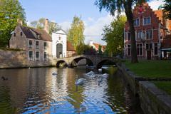 minnewater pond and begijnhof, brugge - stock photo