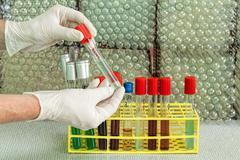 Chemist showing test tube Stock Photos