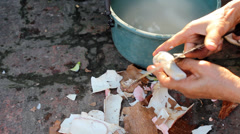 Rural woman cut cassava for food Stock Footage