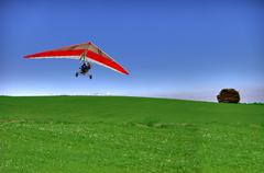 Hang glider on green - stock photo
