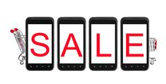 Sale on smart phone with shopping cart - stock photo