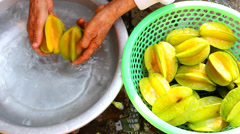 Washing star fruits Stock Footage