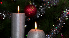 Candle lit in front of festive lights Christmas tree, FULL HD Stock Footage
