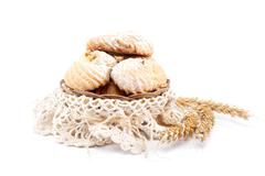 Cookies with powdered sugar in a linen package and ears on white background. Stock Photos