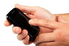 modern touchscreen mobile phone in hand isolated on white background. - stock photo