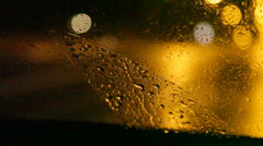 Close up of a windshield wiper at night. - stock footage