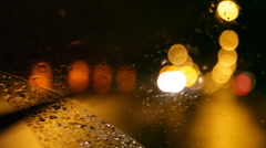 Close up of a windshield wiper at night Stock Footage