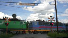 Cargo train passing a railroad crossing Stock Footage