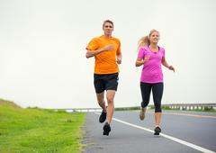 fitness sport couple running jogging outside - stock photo