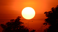 sunset with electricity pylon - stock footage