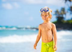 happy young boy having fun at the beach - stock photo