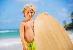 happy young boy having fun at the beach on vacation - stock photo