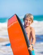 happy young boy having fun at the beach on vacation, - stock photo