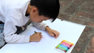 Stock Video Footage of boy drawing with crayons