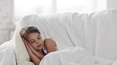 Pre-teen girl sleeping at home Stock Footage