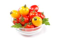 tomatoes in a glass isolated on a white background. - stock photo
