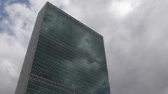 United Nations Organization Building New York City Manhattan Headquarters Cloudy Stock Footage