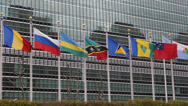 Stock Video Footage of United Nations Building Landmark International Flags Diplomat Conflict Sanction